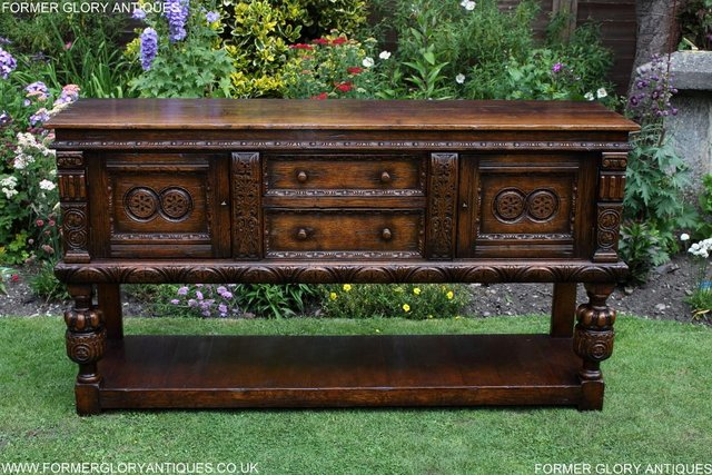Preview of the first image of A TITCHMARSH AND GOODWIN CARVED OAK DRESSER BASE SIDEBOARD.