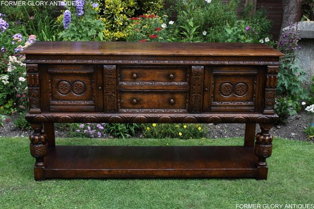 Image 27 of A TITCHMARSH AND GOODWIN CARVED OAK DRESSER BASE SIDEBOARD