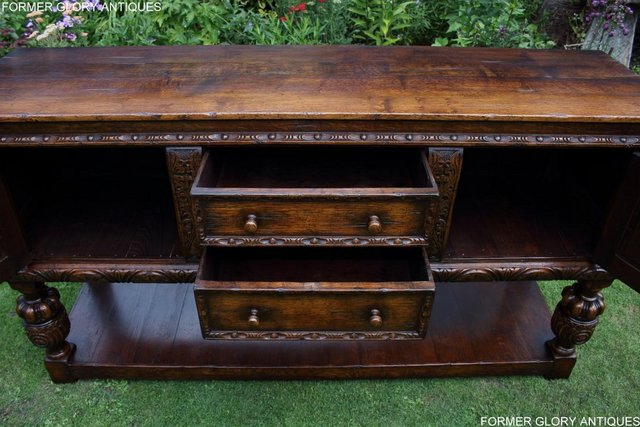 Image 49 of A TITCHMARSH AND GOODWIN CARVED OAK DRESSER BASE SIDEBOARD