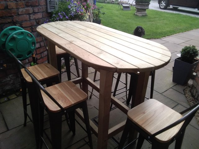 Preview of the first image of Out door table and chairs.