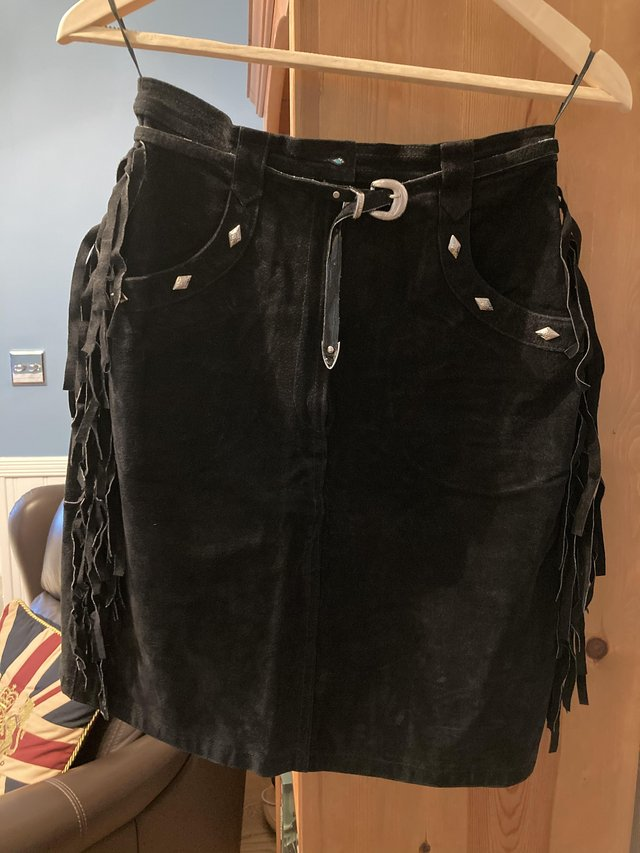 Preview of the first image of Vintage 1988 Suede Fringed Cowgirl Skirt.