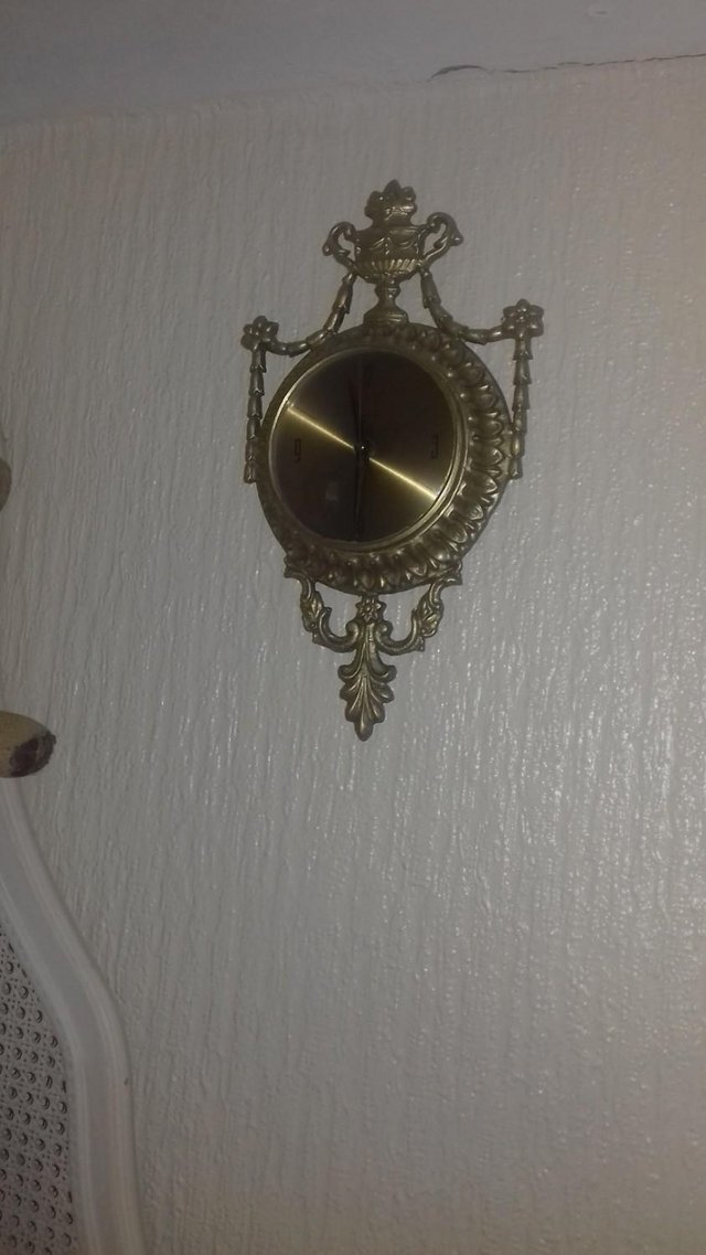 Preview of the first image of ornate..gilt..wall..clock.