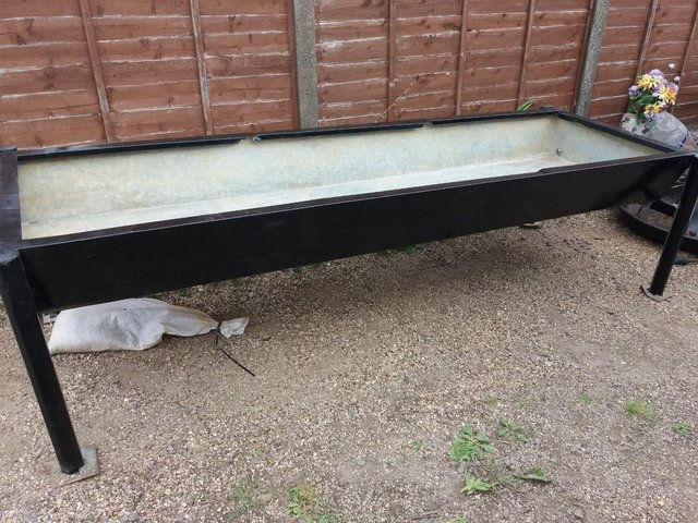 Preview of the first image of metal trough raised Garden planter ideal for wheelchair user.