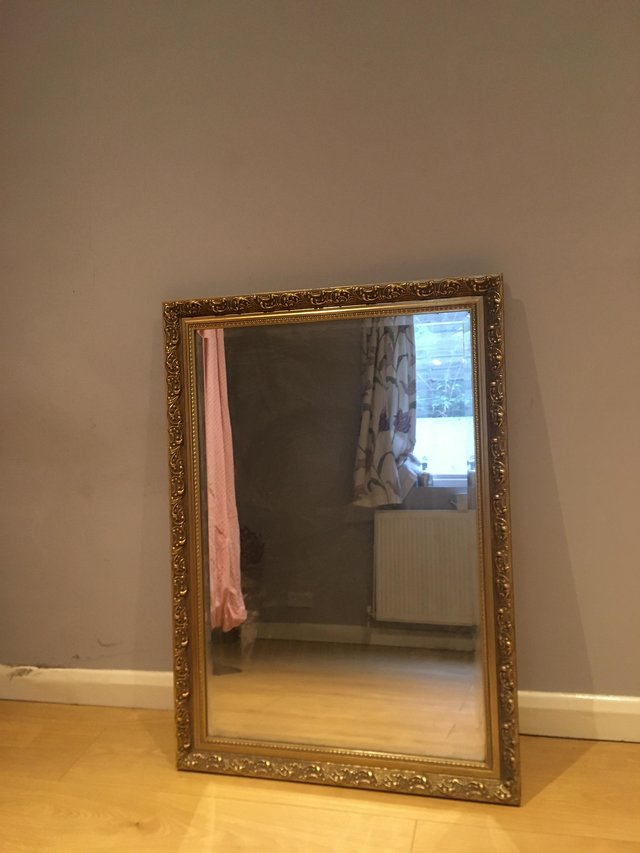 Preview of the first image of Antique Large gold brass mirror.
