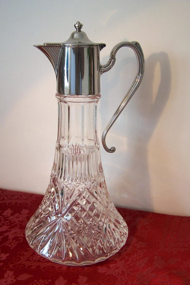 Preview of the first image of Vintage Style Crystal Decanter – Silver plated Top & Handle.