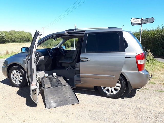 Preview of the first image of WAV Evolution Kia Sedona 3 Auto up front wheelchair car.
