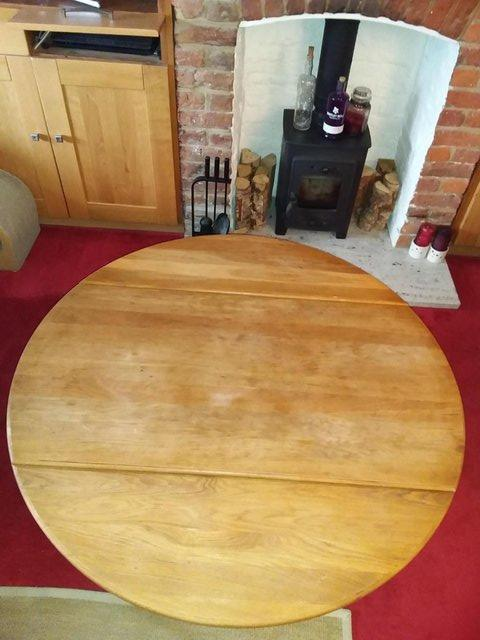Preview of the first image of Solid oak drop leaf coffee table.