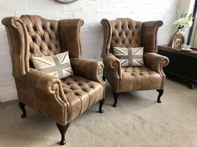 Image 2 of Tan Queen Anne wingback Chesterfield armchairs. Delivery.