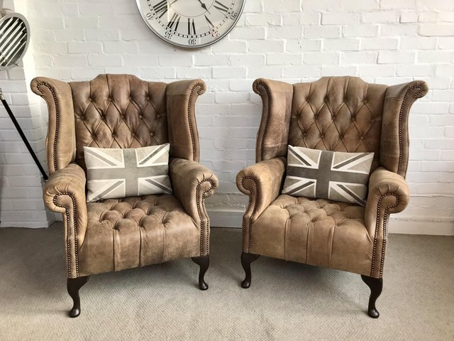 Preview of the first image of Tan Queen Anne wingback Chesterfield armchairs. Delivery..
