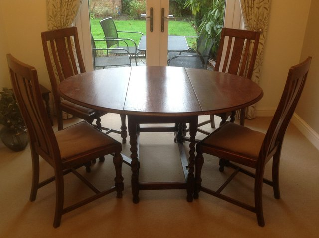 Preview of the first image of 1930's Oak drop leaf Dining table &4 Chairs.