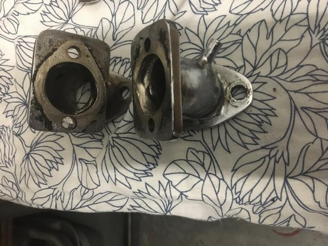 Preview of the first image of Pair of custom manifolds to convert P/unit Triumph 650 to.