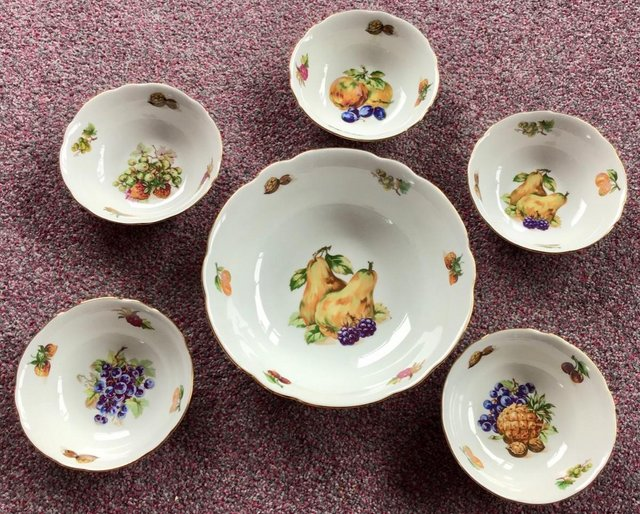Preview of the first image of Lovely UNUSED vintage large bowl and matching dishes.