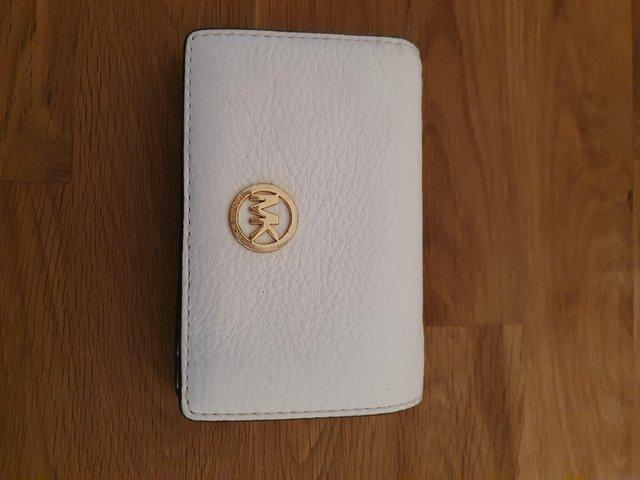 Preview of the first image of Genuine Michael Kors purse.
