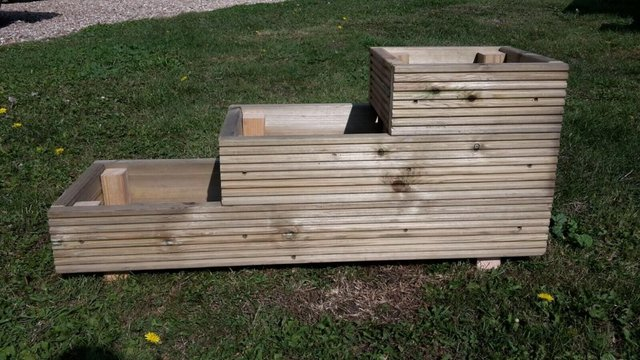 Preview of the first image of WOODEN 3 TIERED DECKING PATIO GARDEN PLANTER 900MM X 300MM.