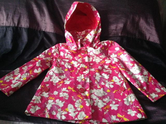 Preview of the first image of Ted Baker girl's floral rain mac Age 3-4 years.