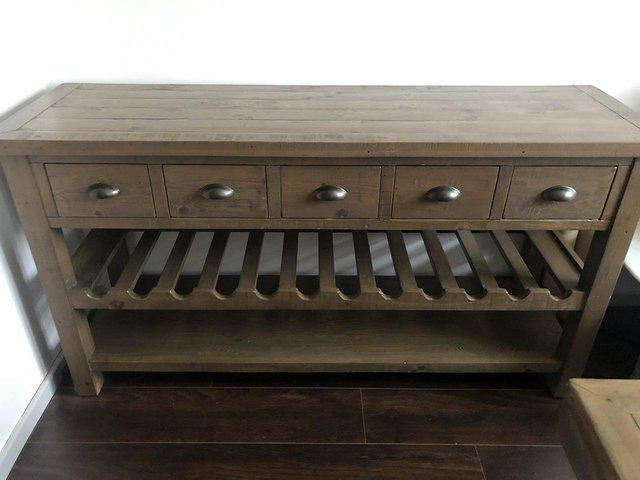 Preview of the first image of Solid Wood Sideboard with drawers and wine rack.