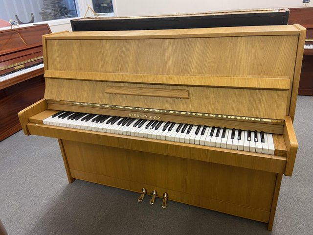 Preview of the first image of Lighter coloured Hermann Mayr piano in excellent condition.