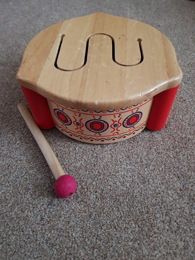 Preview of the first image of Children's Wooden Drum and Drumstick.