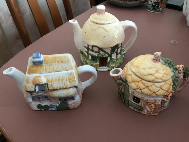 Preview of the first image of 3 Decorative Cottage Teapots.