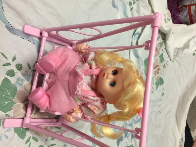 Preview of the first image of Battery Operated Automatic Swing And Sing Baby Doll Kids Xm.