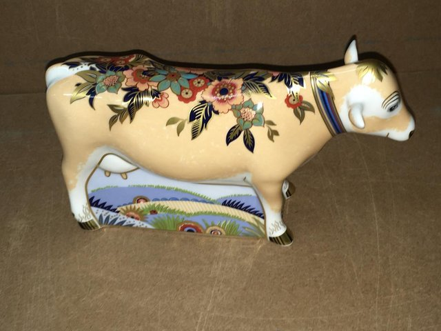 Preview of the first image of Boxed New Royal Crown Derby Farmyard Cow Paperweight.