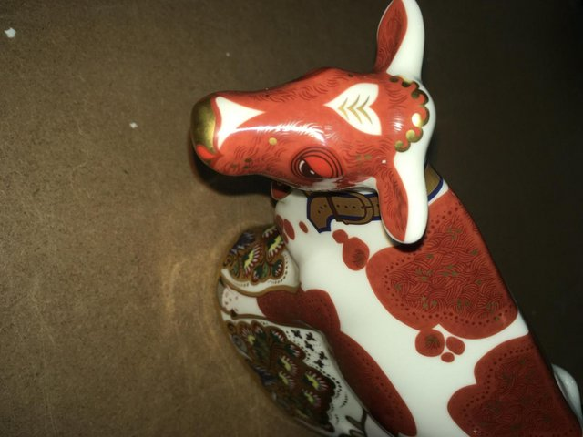 Preview of the first image of Royal Crown Derby Cow Paperweight.