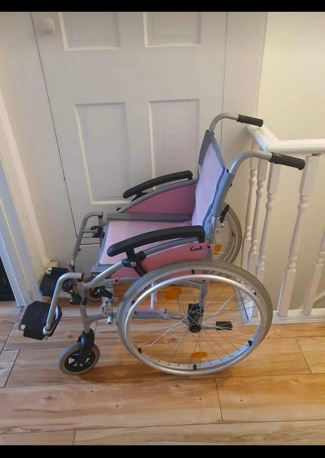 Preview of the first image of I-Go Candi Self Propelled Wheelchair.