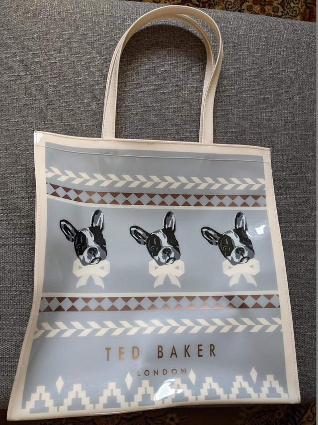 Preview of the first image of HARDLY USED TED BAKER HARD PLASTIC SHOPPING BAG DOG.
