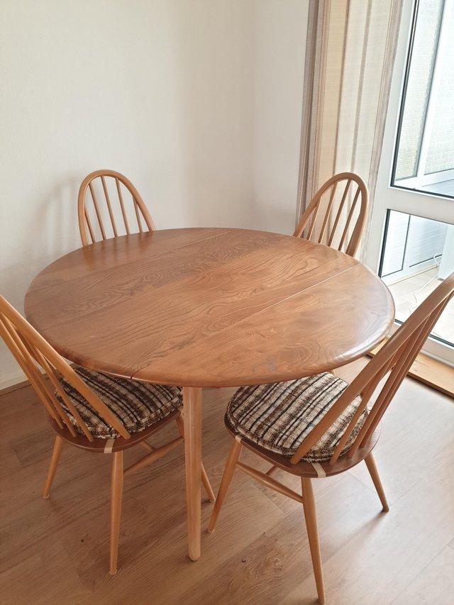 Preview of the first image of Ercol dining table and 4 chairs.