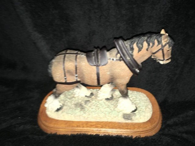 Preview of the first image of Large vintage shire horse ornament on wooden plinth.