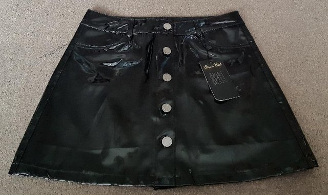 Preview of the first image of BNWT Pretty Little Thing Black Vinyl Mini Skirt - Size 14.
