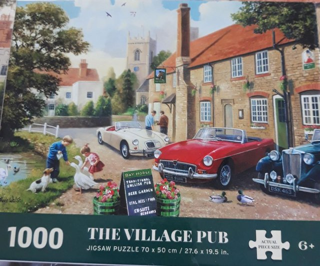 Preview of the first image of Nostalgia 1000 Jigsaw Puzzle deluxe Village Pub.