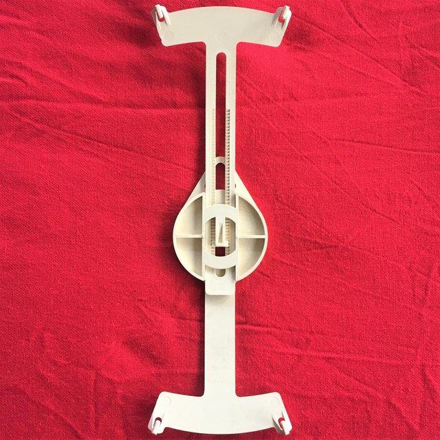 Image 3 of Vintage 1970s adjustable cream plastic plate hanger.