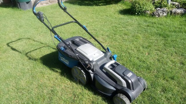 Preview of the first image of Mac Allister 1600w electric lawnmower.