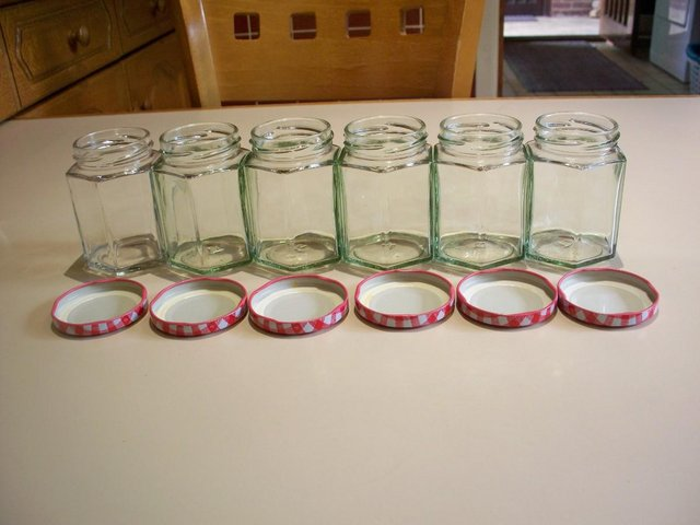 Image 2 of 6 used glass jam jars 8oz hexagonal with red gingham lids