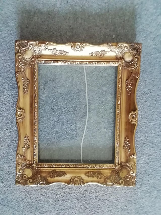 Preview of the first image of Ornate gold coloured picture frame, leybourne.