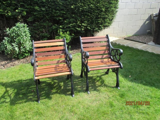 Image 2 of a pair of garden seats