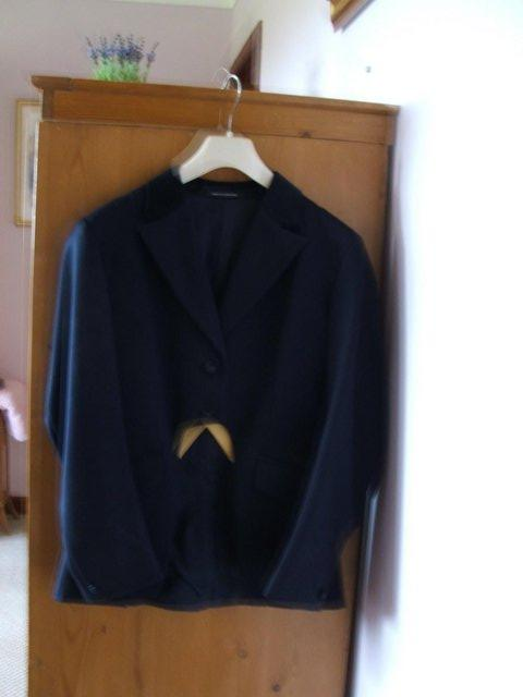 Preview of the first image of Ladies navy cutaway show jacket.