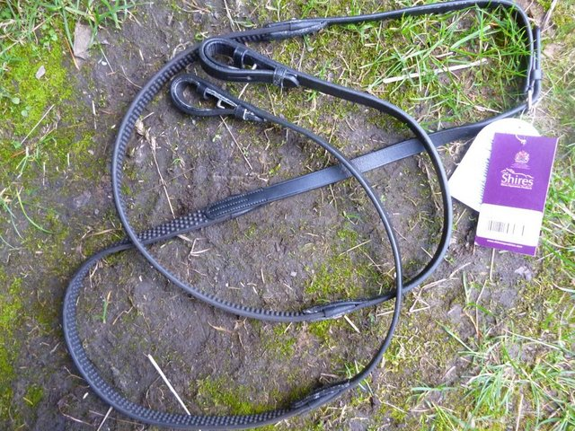 """Preview of the first image of New Brown 48"""" Rubber Soft Grip Reins."""