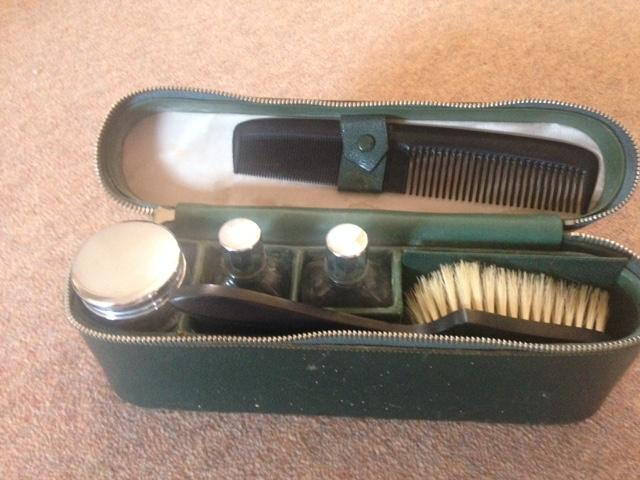 Preview of the first image of Antique believed military green zip travelling case.
