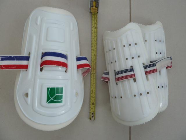 Preview of the first image of 1 pair children's sports shin pads  + 2 pairs hockey socks.