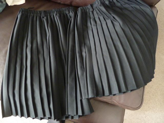 Preview of the first image of 2 x black pleated school skirts, 2 sizes.