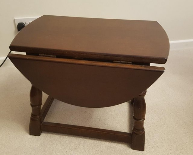 Preview of the first image of Small solid oak drop leaf coffee table, excellent condition..