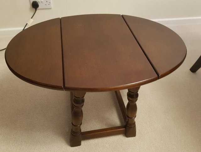 Image 2 of Small solid oak drop leaf coffee table, excellent condition.