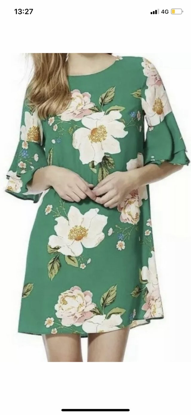 Preview of the first image of Brand New Green Floral Dress Size 12.