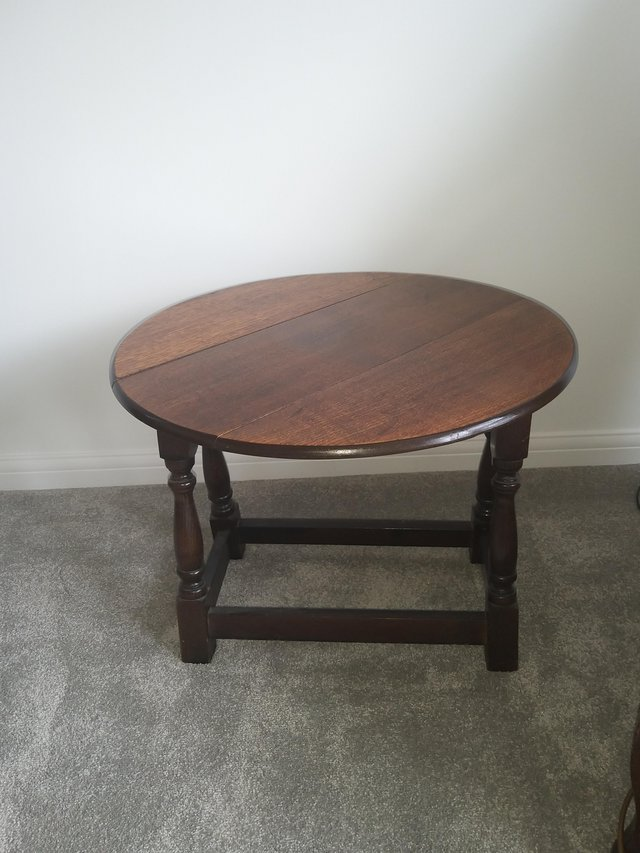 Preview of the first image of Dark wood occasional drop leaf(twist) side/lamp table.