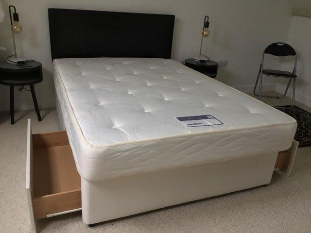 """Preview of the first image of 4'6"""" double bed divan with uPVC headboard and 2 storage draw."""
