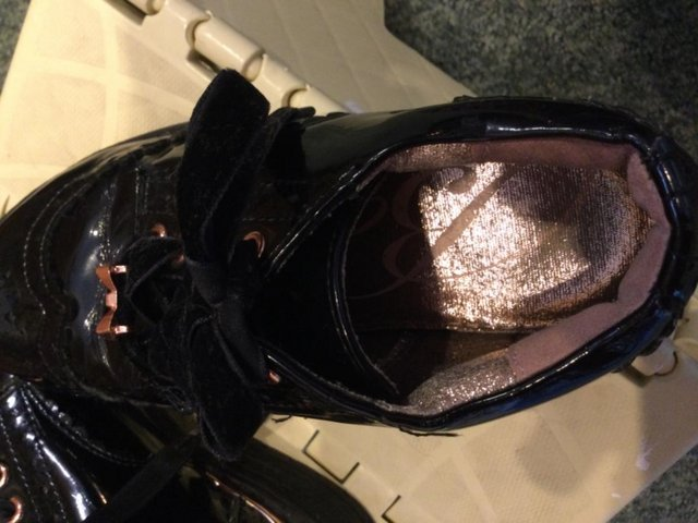 Preview of the first image of Ted Baker girls patent shoes.
