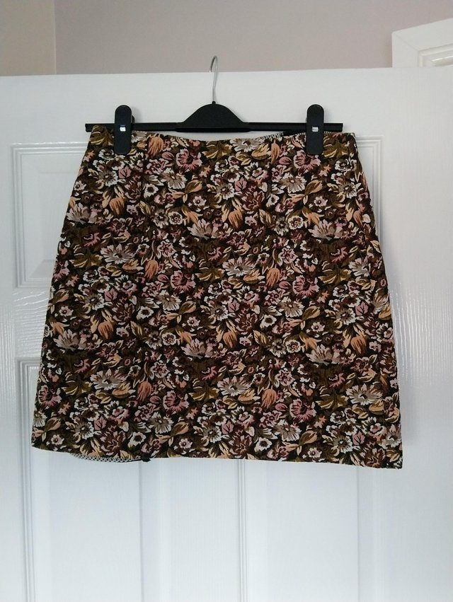 Preview of the first image of Mini floral skirt from M & S size 10.