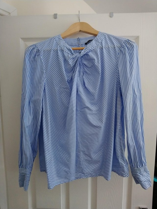 Preview of the first image of M & S Blue Stripey Top size 12.